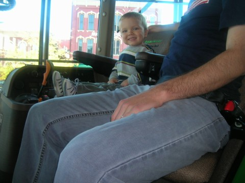 Driving a tractor at the John Deere Pavilion in Moline, IL (with G&G V)