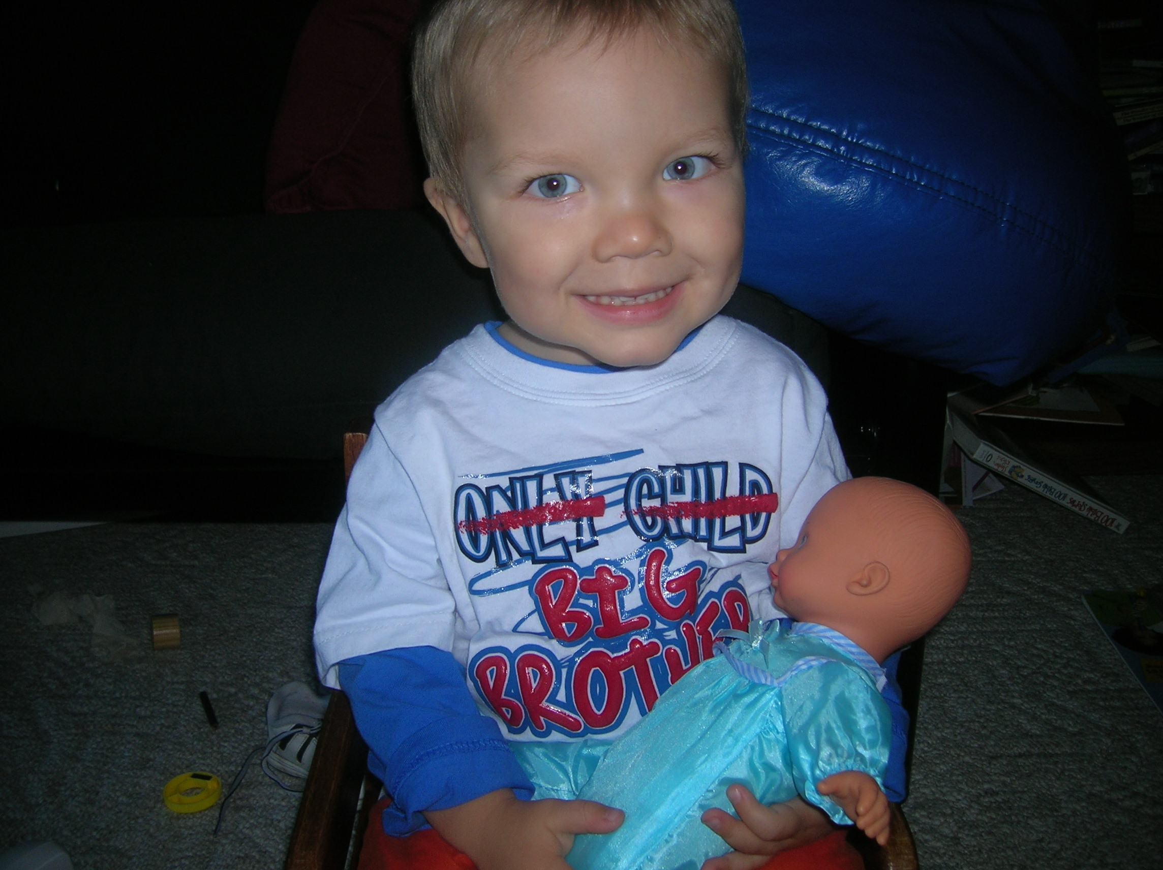 Practicing being a big brother - wearing his new shirt from Grandma